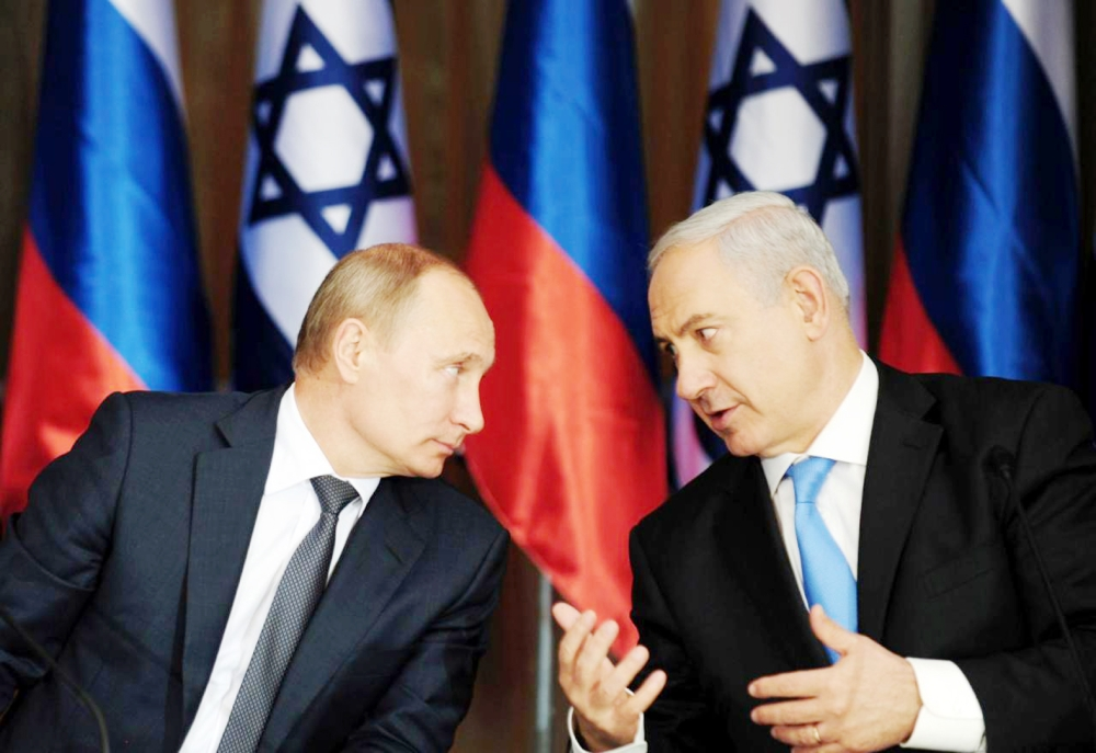 بوتين ورئيس الوزراء الإسرائيلي نتنياهو في لقاء سابق. (وكالات)
