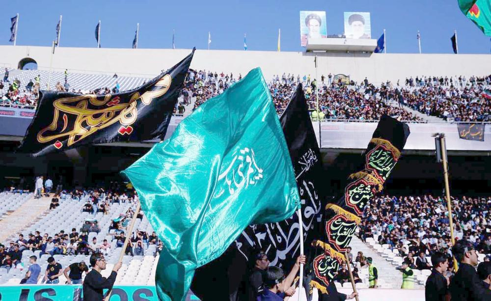 جماهير إيرانية تخلط الرياضة بعقائدها قبل مباراة إيران وكوريا الجنوبية.