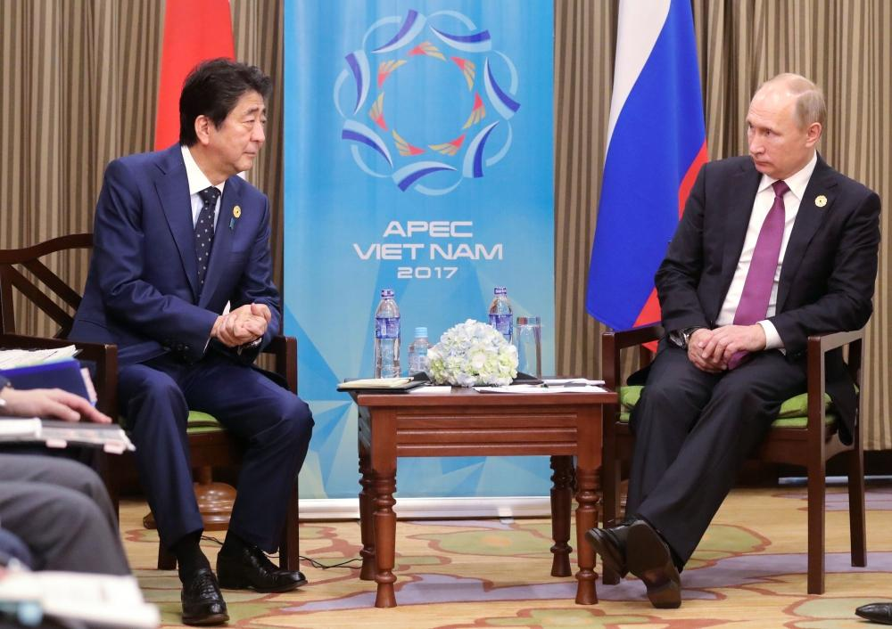 آبي يتفق مع بوتين على تطبيق العقوبات الدولية على بيونغ يانغ