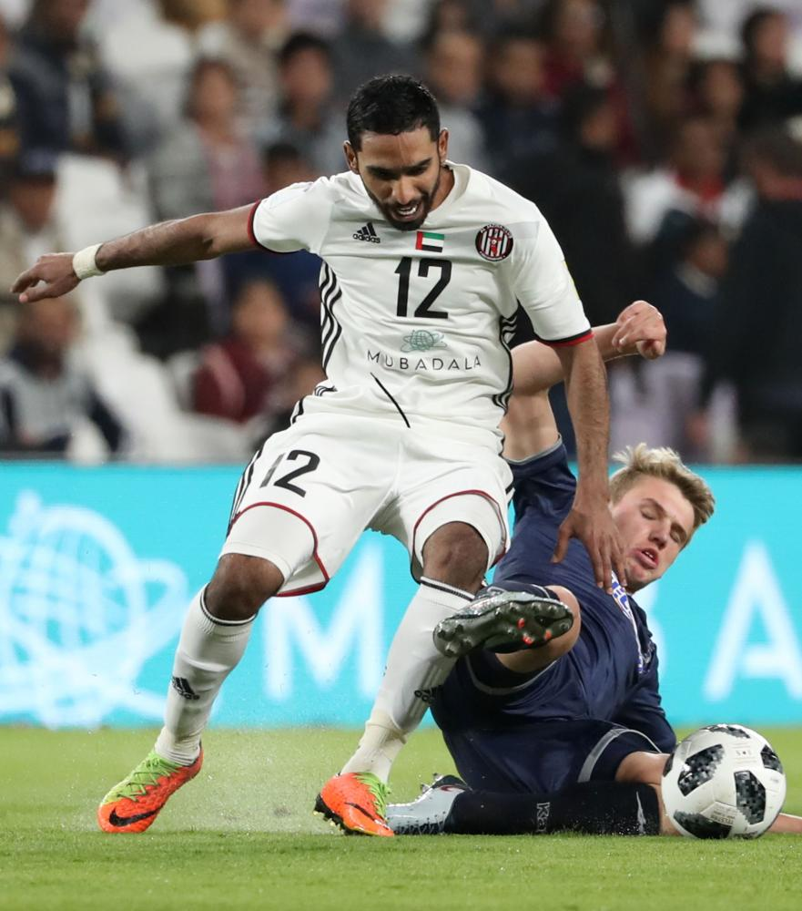 Auckland City's Callum McCowatt (R) fights for the ball against UAE's al-Jazira club Salim Rashid (L) during their FIFA Club World Cup UAE 2017 first round football match between Al-Jazira and Auckland City FC at the Hazza Bin Zayed Stadium on December 6, 2017 in Al-Ain. / AFP / KARIM SAHIB