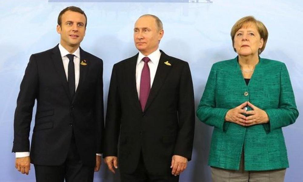 ماكرون وميركل سيبحثان مع بوتين وقف اطلاق النار في سورية