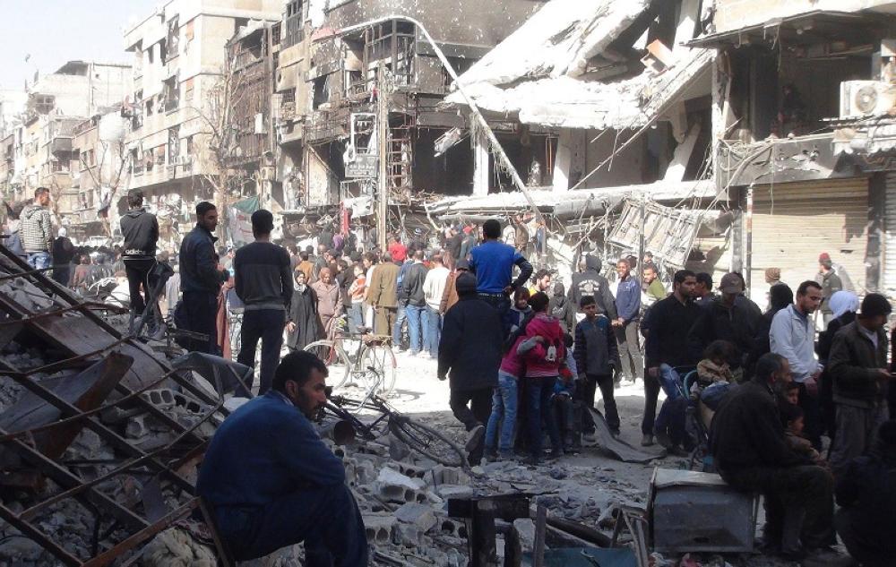 فلسطينيون في مخيم اليرموك بدمشق