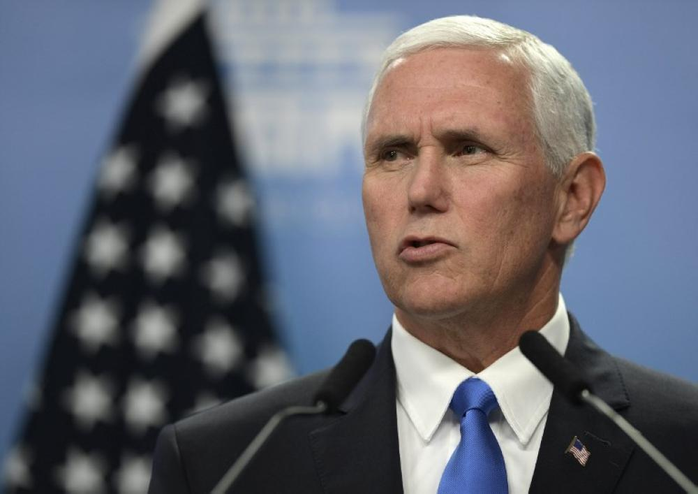 (FILES) This file photo taken on August 15, 2017 shows US Vice President Mike Pence during a joint press conference with Argentina's President Mauricio Macri (not framed) after a working meeting at the Olivos presidential residence in Olivos, Buenos Aires. US Vice President Mike Pence will still head to the Middle East late January 19, 2018 for a high-stakes trip, despite the threat of a federal government shutdown looming over Washington, his spokeswoman said. «The vice president's meetings with the leaders of Egypt, Jordan, and Israel are integral to America's national security and diplomatic objectives,» his press secretary Alyssa Farah told AFP. «The vice president will travel to the Middle East as scheduled.» / AFP PHOTO / JUAN MABROMATA