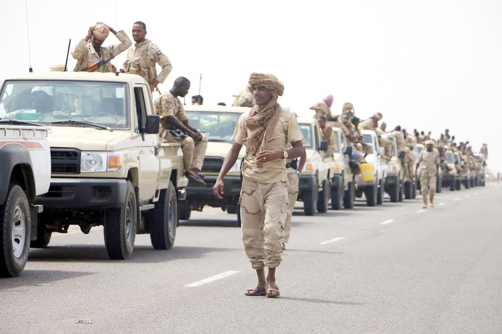 epa06803024 Sudanese forces fighting alongside the Saudi-led coalition in Yemen gather near the outskirts of the western port city of Hodeidah, Yemen, 12 June 2018. According to reports, the Saudi-led military coalition and Yemeni government forces continue to send reinforcements toward the port city of Hodeidah, preparing to launch an assault on the Houthis-controlled main port of Yemen.  EPA/NAJEEB ALMAHBOOBI