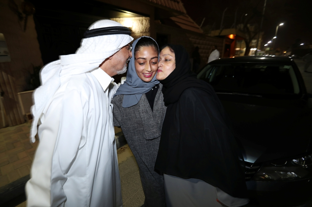 Hannan Iskandar is kissed by her parents, after she drove her car in her neighborhood, in Al Khobar, Saudi Arabia, June 24, 2018. REUTERS/Hamad I Mohammed
