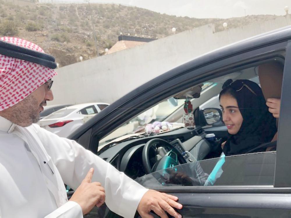 أول سيدة تقود سيارتها في الباحة متحدثة لـ«عكاظ».