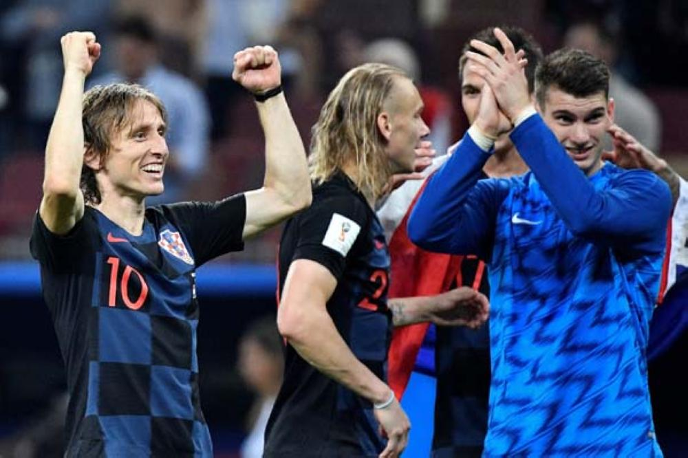 Croatia's midfielder Luka Modric celebrates his team's victory at the end of the Russia 2018 World Cup semi-final football match between Croatia and England at the Luzhniki Stadium in Moscow on July 11, 2018. RESTRICTED TO EDITORIAL USE - NO MOBILE PUSH ALERTS/DOWNLOADS   / AFP / Alexander NEMENOV / RESTRICTED TO EDITORIAL USE - NO MOBILE PUSH ALERTS/DOWNLOADS