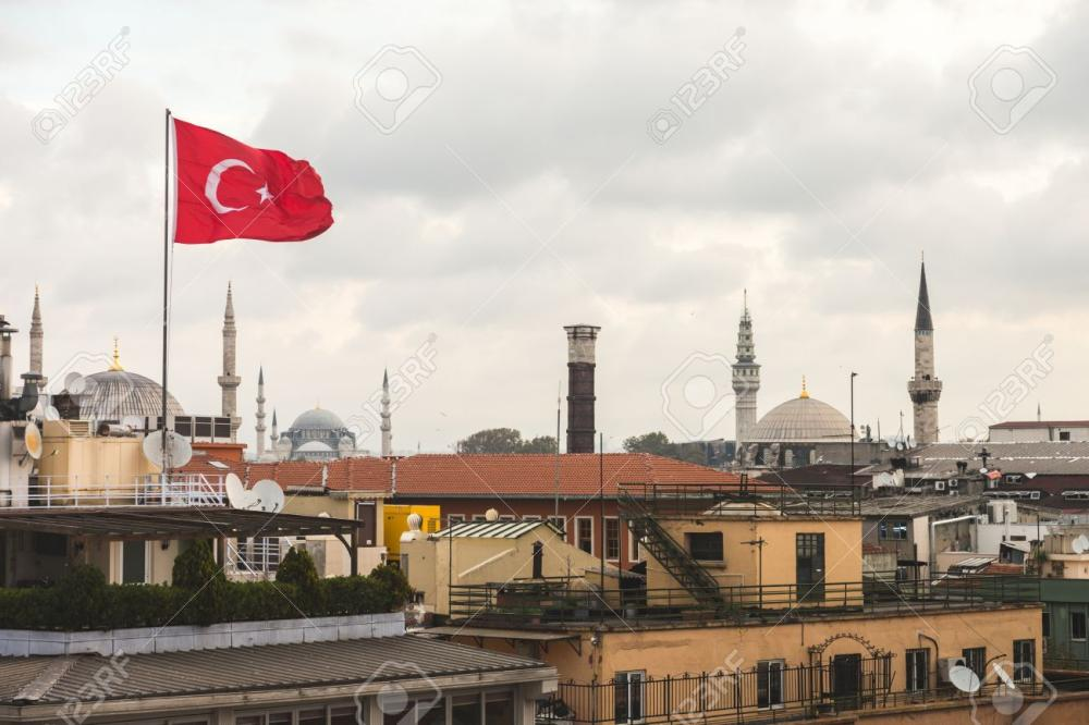 Turkish Flag and Istanbul Rooftops View with Mosque on Background