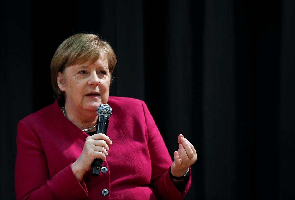 German Chancellor Angela Merkel speaks during a visit at the German School of Athens, Greece, January 11, 2019. REUTERS/Costas Baltas