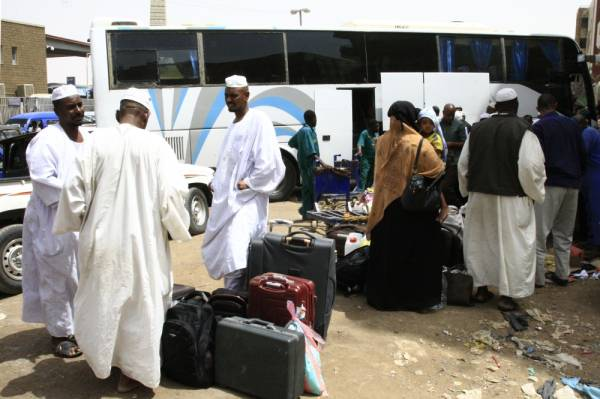 Passengers wait for their shuttle at the main bus station in Khartoum, linking the Sudanese capital with various parts of the country, on June 12, 2019. Shops began to reopen in Sudan's capital but many residents stayed indoors even as demonstrators called off a nationwide civil disobedience campaign launched after a deadly crackdown in Khartoum killed dozens. As a breakthrough came after mediations led by Ethiopian Prime Minister Abiy Ahmed, who visited Khartoum last week, the United Nations Security Council called on the ruling generals and protest leaders to resolve the crisis triggered by the June 3 crackdown on protesters. / AFP / -