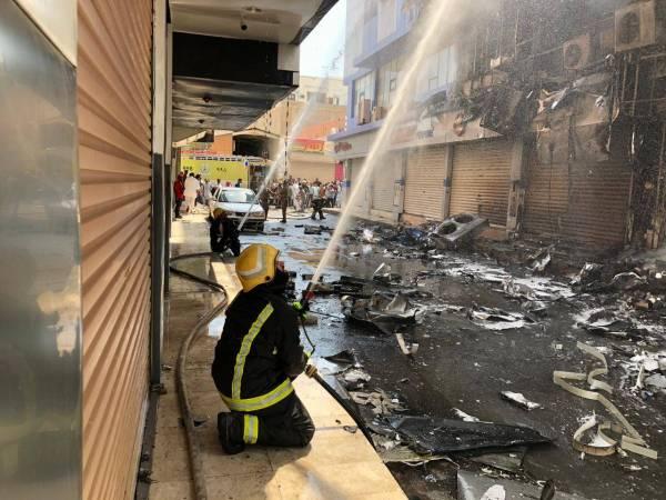 إخماد حريق بمبنى تجاري وسط ينبع