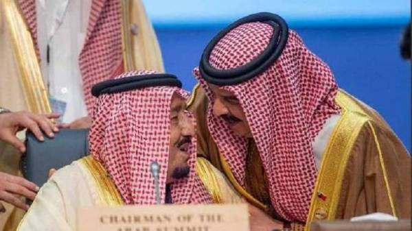 خادم الحرمين الشريفين وملك البحرين