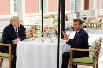 US President Donald Trump (L) sits to lunch with French President Emmanuel Macron, at the Hotel du Palais in Biarritz, south-west France on August 24, 2019, on the first day of the annual G7 Summit attended by the leaders of the world's seven richest democracies, Britain, Canada, France, Germany, Italy, Japan and the United States.  / AFP / POOL / ludovic MARIN