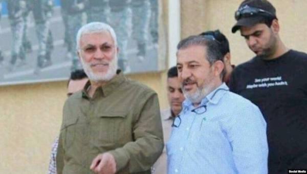 اللامي برفقة أبو مهدي المهندس. (موقع المقاومة الإيرانية)