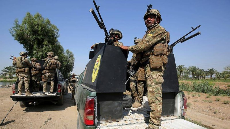 جنود وآليات تابعة للجيش العراقي
