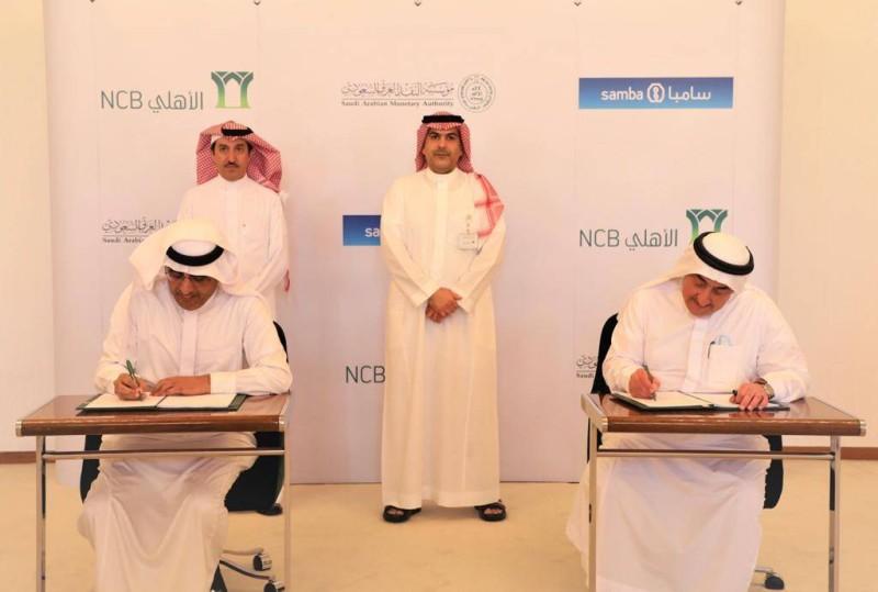 عمار الخضيري وسعيد الغامدي خلال توقيع الاتفاقية