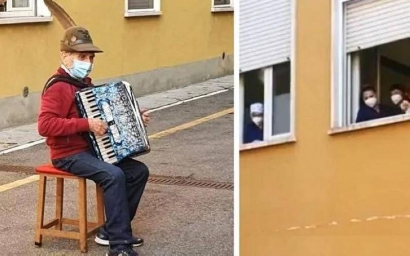 بوزيني يعزف لزوجته من تحت نافذة عنبر المستشفى.
