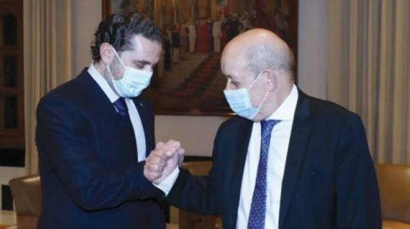 الحريري ووزير الخارجية الفرنسي.