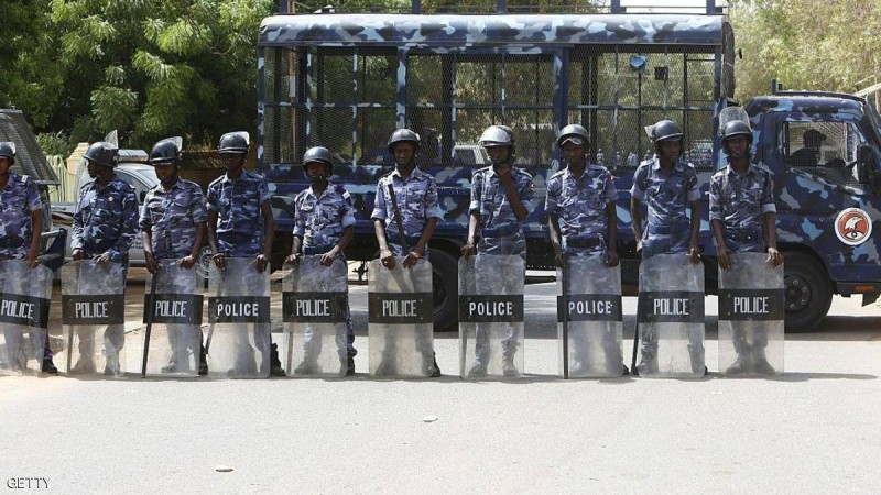 Sudanese police stand guard as hundreds of Sudanese Islamists demonstrate outside a United Nations office in central Khartoum on May 22, 2015, to protest the death sentence handed out to Egypt's ousted president Mohamed Morsi and dozens of other co-defendants by a court in Cairo on May 16. Morsi was among more than 100 defendants ordered by an Egyptian court to face the death penalty for their role in a mass jailbreak during the 2011 uprising. AFP PHOTO / ASHRAF SHAZLY (Photo credit should read ASHRAF SHAZLY/AFP/Getty Images)