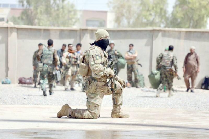 قوات أفغانية في هلمند أمس.